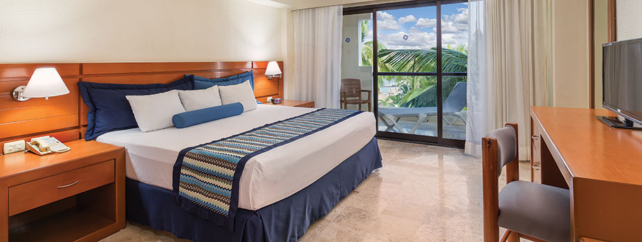 A King Bed in a 1 bedroom unit at the Plaza Pelicanos Grand Beach Resort